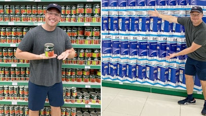 Benny Johnson posing in front of fully stocked shelves in a Cuban supermarket