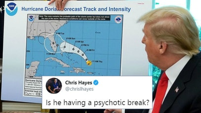 Donald Trump with the weather map he altered to make it look like Hurricane Dorian will hit Alabama