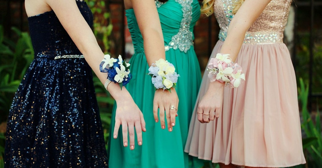 Girls showing off their school dance corsages