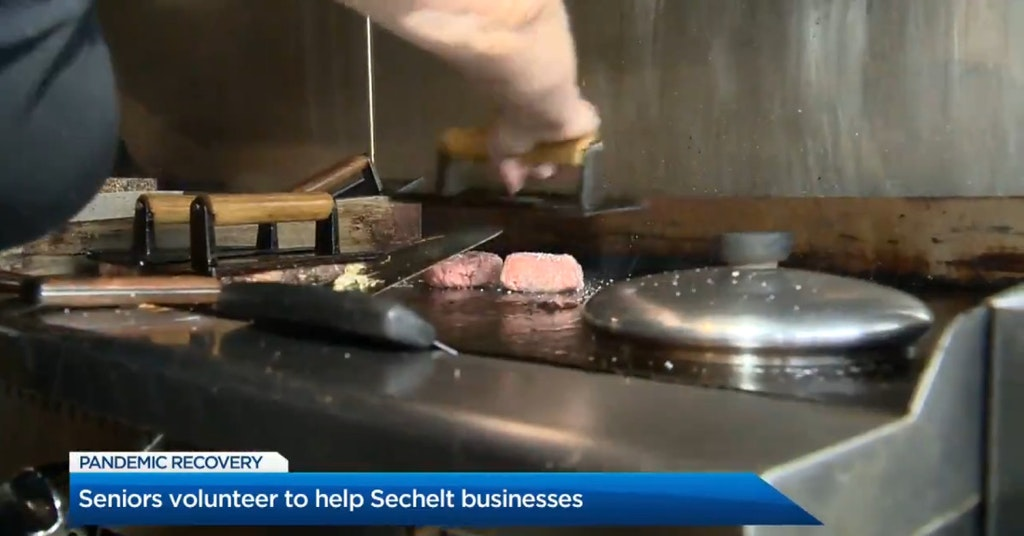 News report showing a grill at a burger restaurant