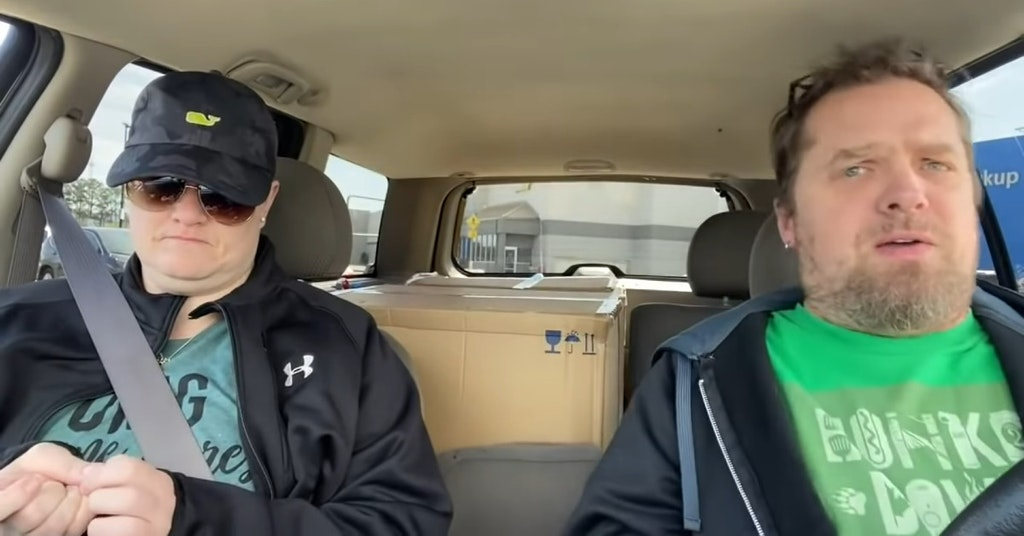 Dusty and Tristan Graham in their car talking about COVID-19