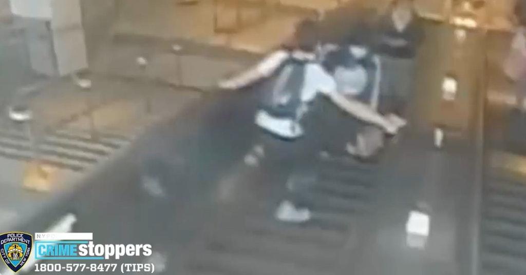 man kicks woman down escalator found