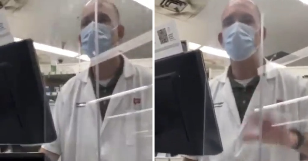Masked pharmacist being filmed at the pharmacy counter