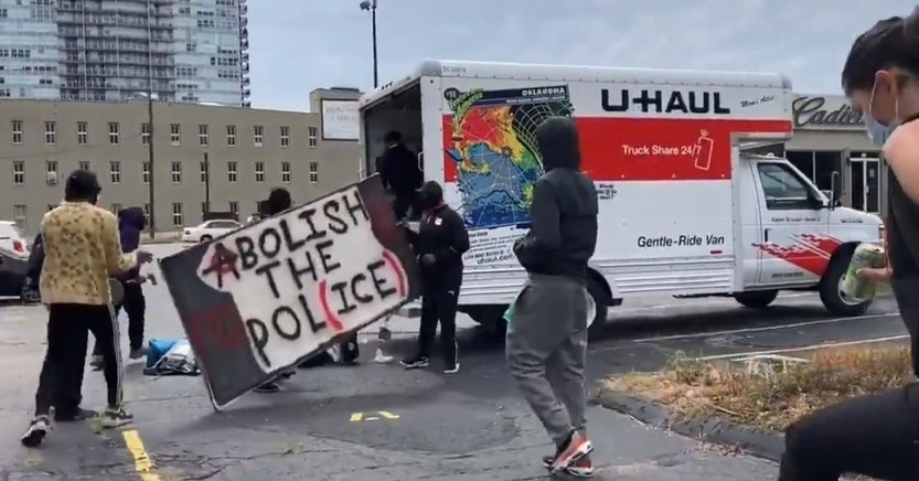 Black Lives Matter protesters getting signs out of a U-Haul truck