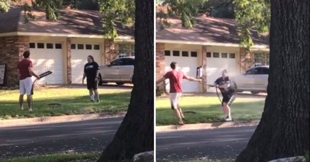 Woman getting soaked by a man with a sprinkler